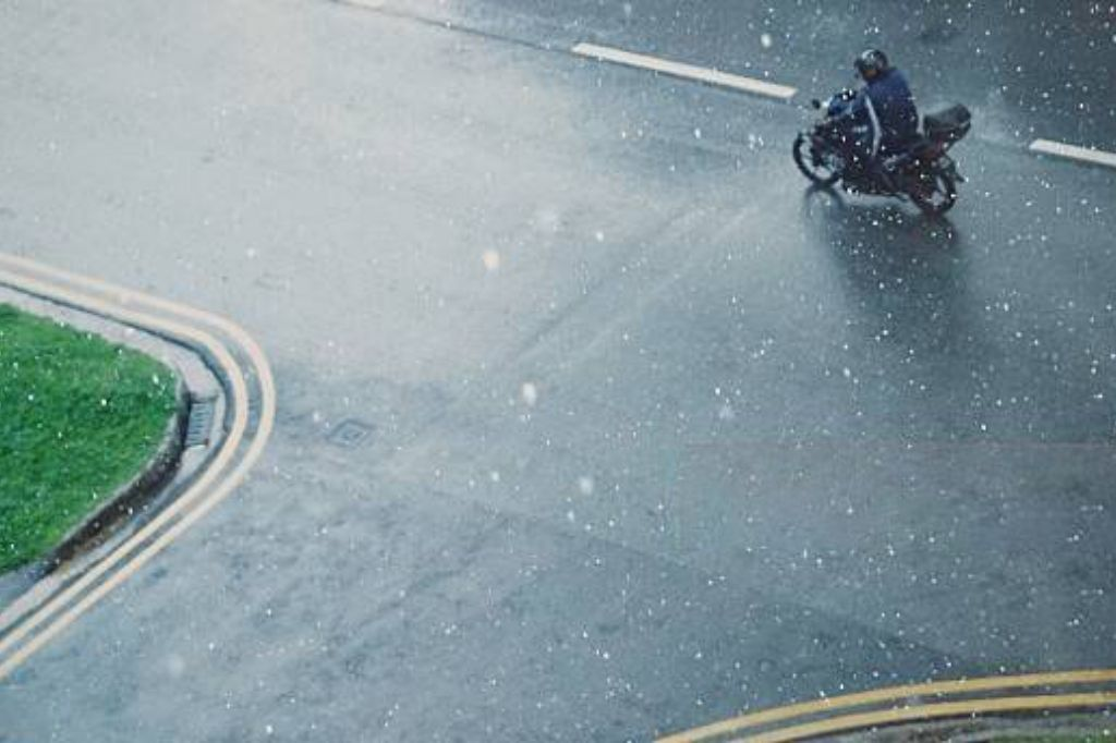 be aware of intersections when riding in the rain