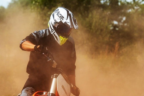 Motorcycle riding with dust in the air