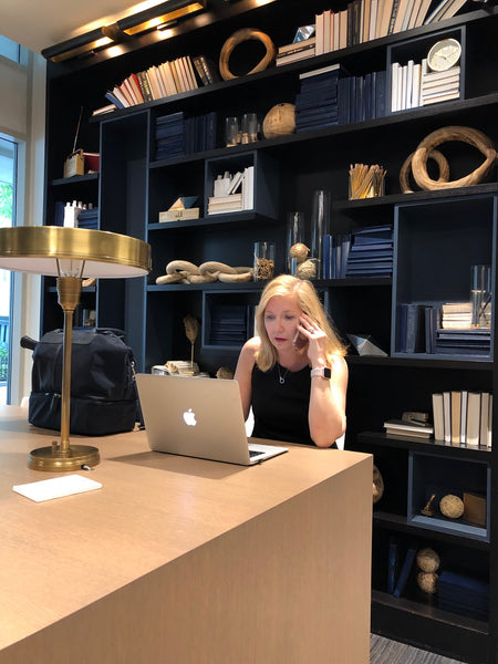 Caroline busy working at her real estate office