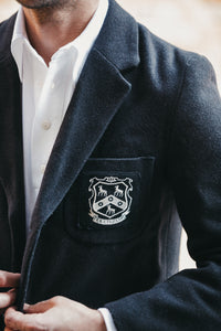 Close up of the N.E. Blake & Co. Peter May Cricket Shirt worn under a vintage blazer