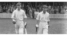 Load image into Gallery viewer, 1938: English cricketers Bill Edrich (1916 - 1986) and Len Hutton (1916 - 1990) come out to bat for England against Australia at the Oval in London