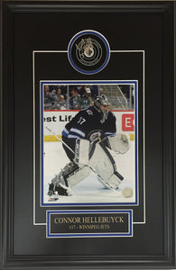 Connor Hellebuyck Autographed Winnipeg Jets Puck Framed