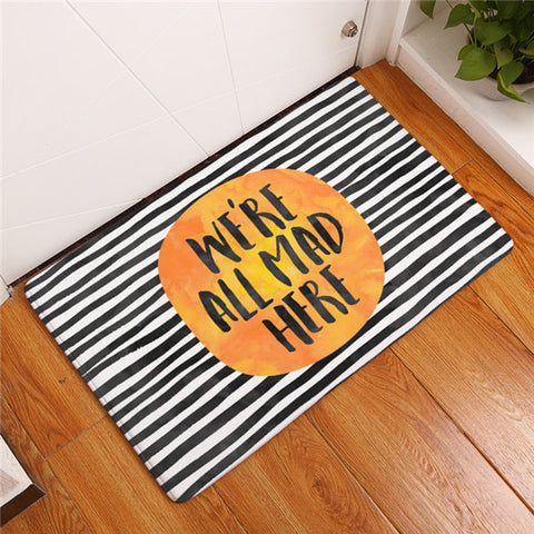 """We are all mad here..."" door mat"