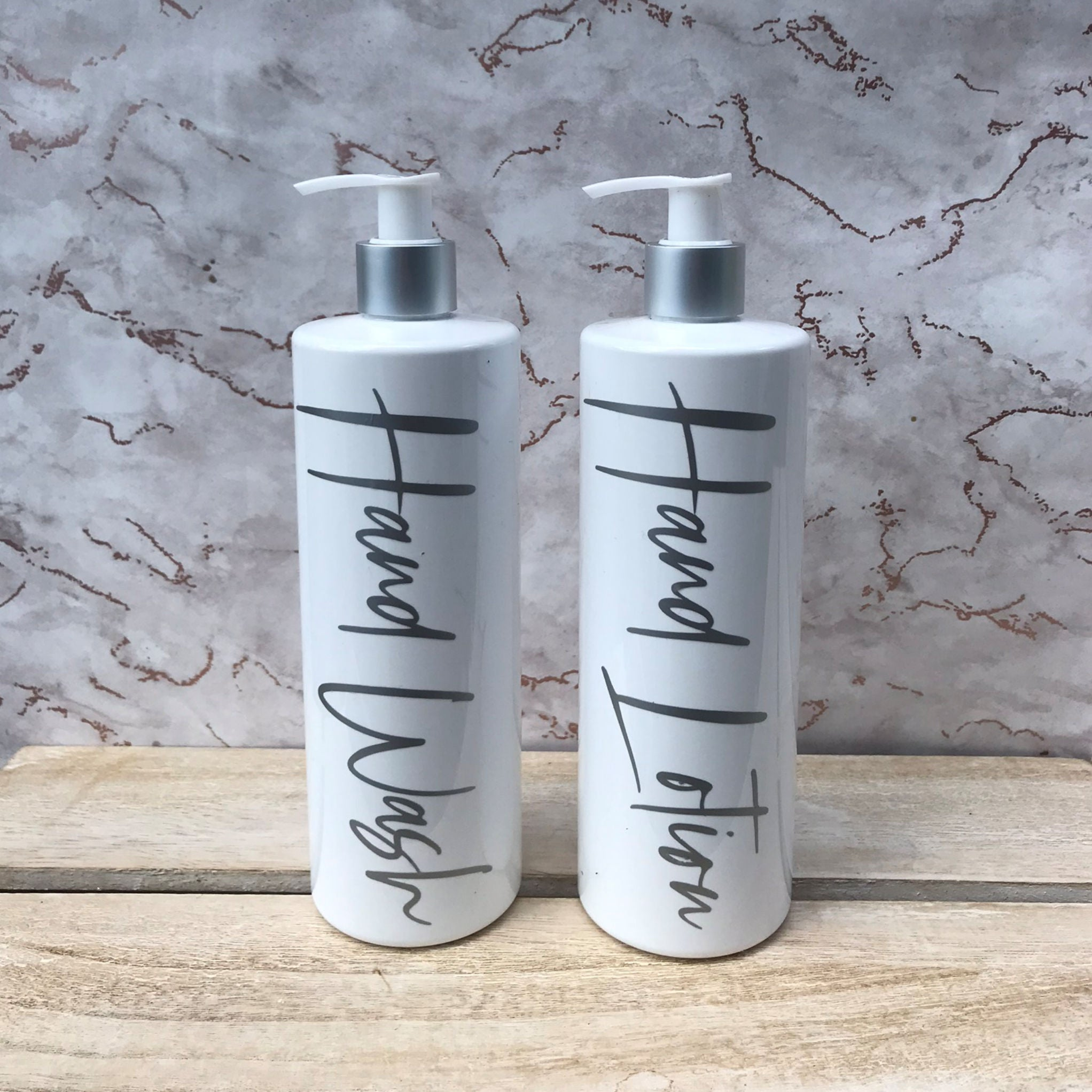 White and Silver Pump Bottles