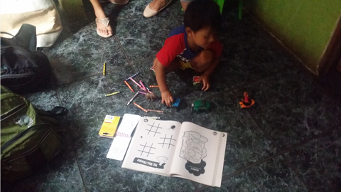 Most coffee pickers in Costa Rica are Nicaraguan migrants looking for better wages. Here is a young boy playing with toys and coloring books that Elba brought for him.
