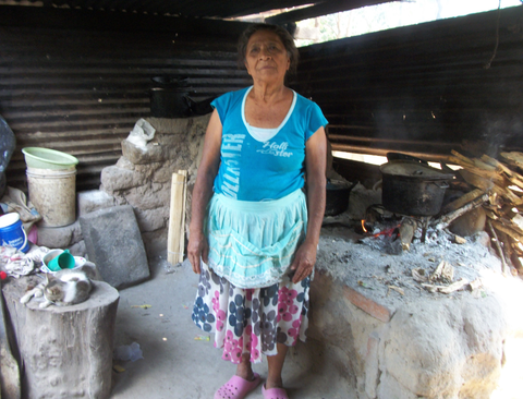 Elba's childhood friend and retired coffee picker, Sabina. This is her kitchen in her Salvadoran home.