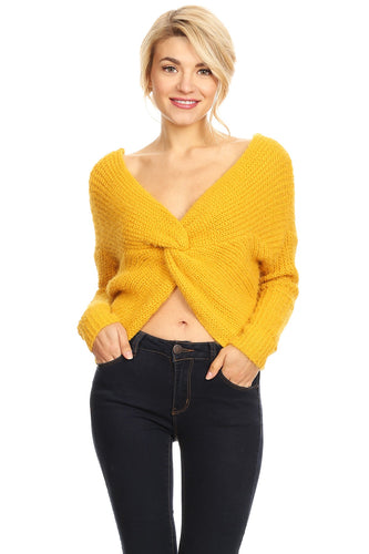 [22608] Chunky knit, cropped sweater in a fitted style with a v-neckline, knotted detail, and long sleeves.