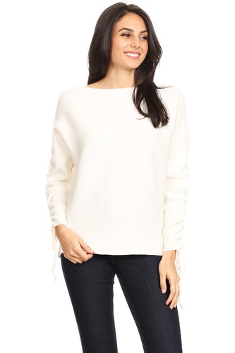 [22609] Thick rib knit, waist length top in a relaxed fit with a boat neckline and long dolman sleeves with ruched details and tied hems.