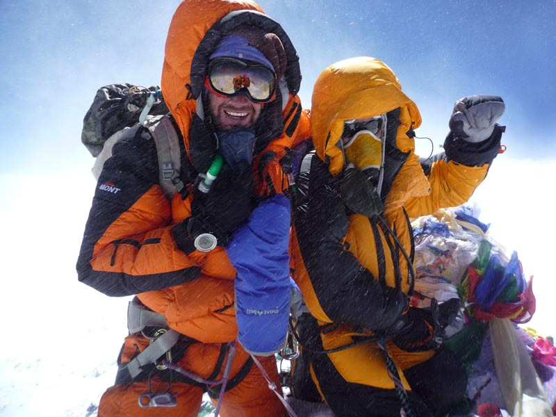 Chris Warner on the summit of Everest.