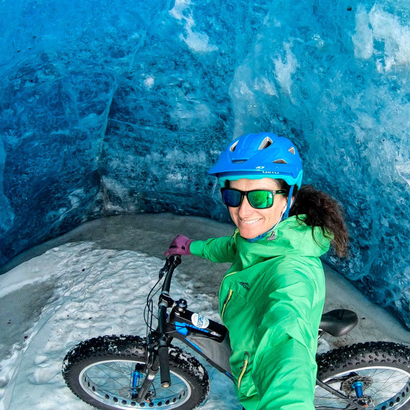 Mont Ambassador Jennie Milton fat biking ona glacier. Wearing Mont Supersonic Jacket