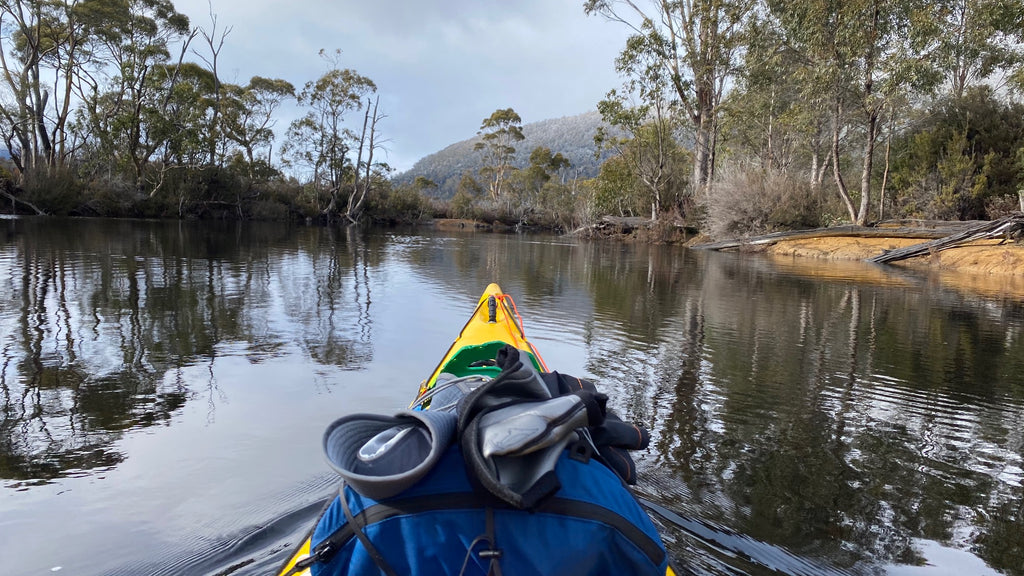 Eric Philips paddling Lake St Clair, Tasmania