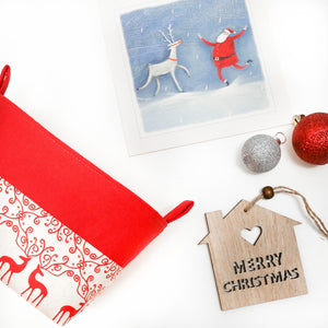 Christmas flatlay with red reindeer Xmas storage basket, scandi Christmas decor, desinged and hand made in Australia by MIMI Handmade Baskets