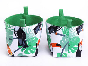 Side view of set of 2 tropical toucan baskets by MIMI Handmade Baskets, Australia