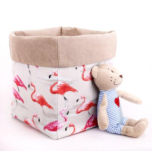 Reversible pink flamingo and beige storage basket for soft toys