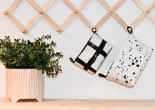Load image into Gallery viewer, small-and-medium-black-monochrome-fabric-storage-baskets-hanging-on-a-hook-next-to-a-plant,-wall-storage-organiser,-monochrome-homewares,-boho-chic-home-decor,-handmade-in-Australia-by-MIMI-Handmade