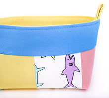 Load image into Gallery viewer, detail of small multicolour shark fabric storage basket for kids, pink, yellow, blue organiser, made by MIMI Handmade Baskets Australia