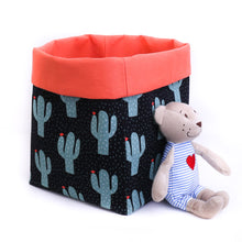 Load image into Gallery viewer, black and orange cactus pattern reversible fabric toy storage bin with teddy bear