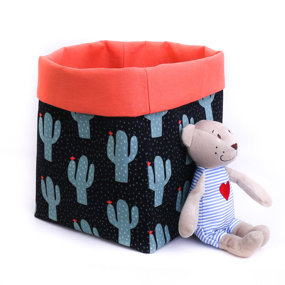black and orange cactus pattern reversible fabric toy storage bin with teddy bear