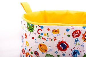 close up to Large toy storage basket by MIMI Handmade Baskets Australia,  yellow cool monsters cube