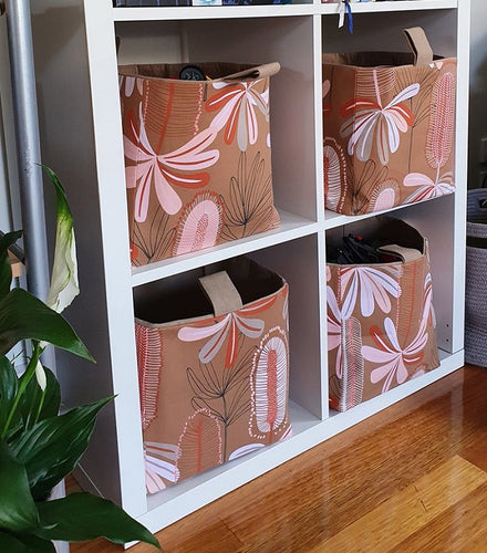 large australiana baskets in kallax cube shelf unit, terracotta banksia fabric pattern, hand made in Australia by MIMI Handmade Baskets