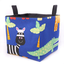 Load image into Gallery viewer, large cube fabric storage basket for kallax in blue with zebra and crocdile print, safari nursery toy storage, handmade by MIMI Handmade Baskets, Australia