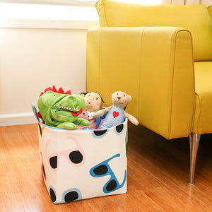 large cube storage basket made with colourful sunglasses fabric pattern filled with soft toys, living room storage solutions, hand made in Australia by MIMI Handmade Baskets