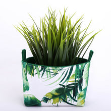 Load image into Gallery viewer, mini green monstera and palm plant pouch storage basket made in Australia by MIMI Handmade Baskets
