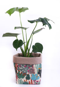 natural beige canvas fabric plant holder with monstera plant handmade with flowering cactus fabric print