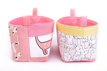 Load image into Gallery viewer, side view of small pink storage baskets for kids, made with cute sausage dog and bunny print, by MIMI Handmade Baskets Australia