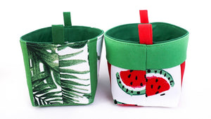 side view of small tropical green storage baskets for kids, made with watermelon and leafy monstera print, by MIMI Handmade Baskets Australia