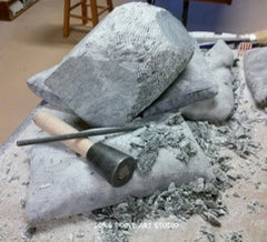 Roughing in a form in soapstone, sculptor Cindy Presant