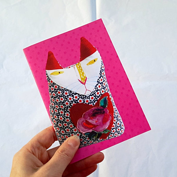 small pink notebook with cat design