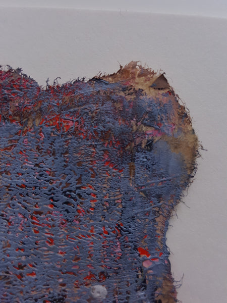 close up of torn edge of painting