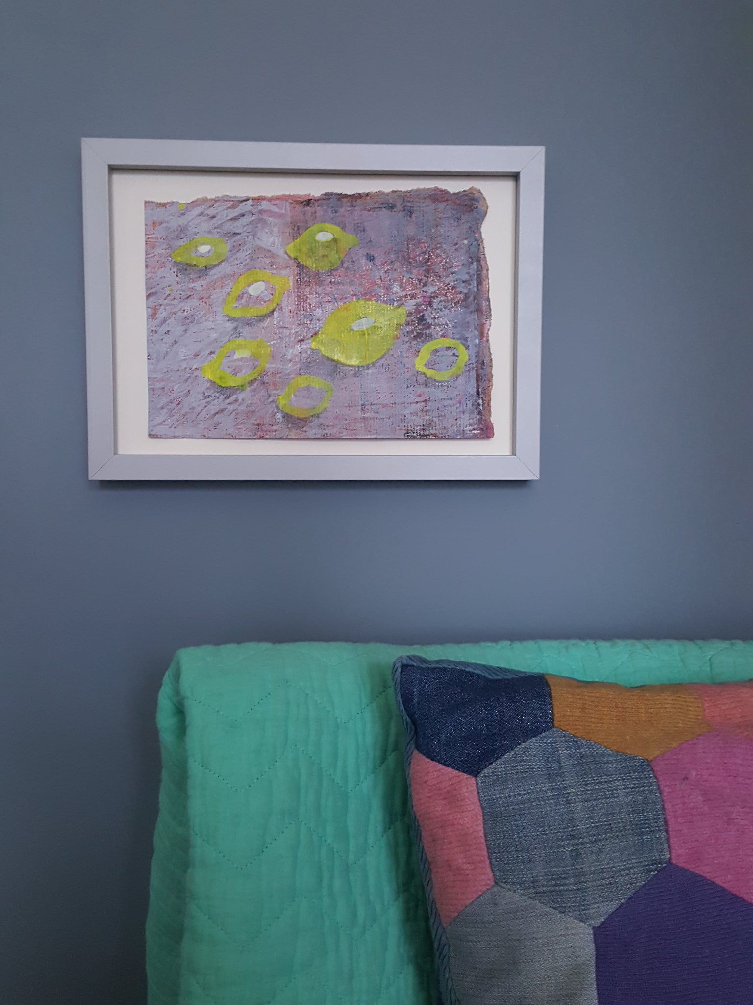 painting of lemons hanging on grey wall