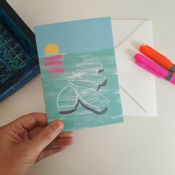 Hand holding greeting card with boats design by Julia Laing.