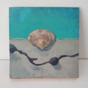 Mini painting of a shell and seaweed