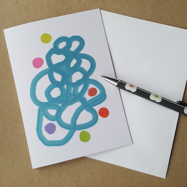 greeting card on desk with white envelope and pencil