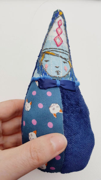 View of blue teardrop girl with hand to show scale.