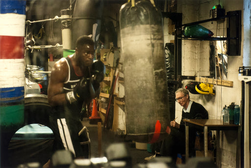 Sully's Gym, Toronto, Ontario, [man sketching boxer during his training]