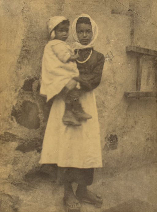 Untitled [Woman holding child]