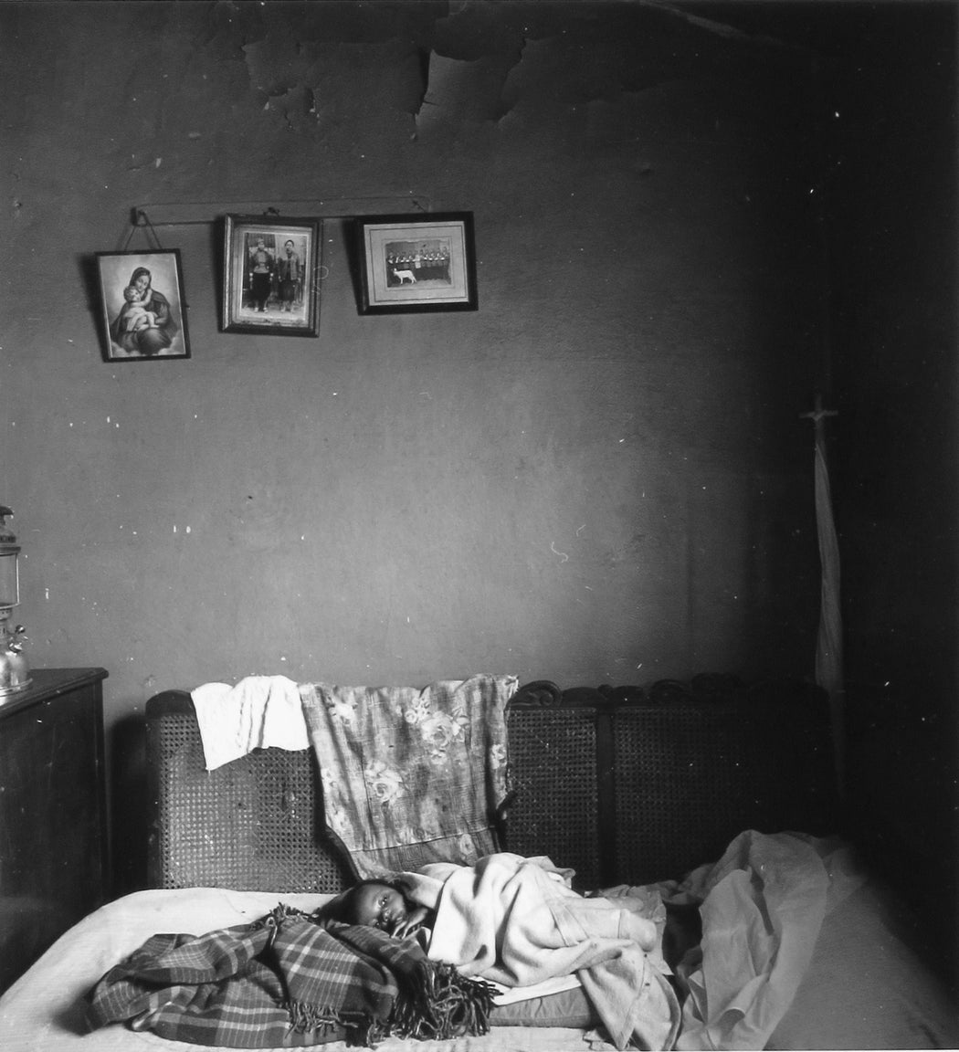 Untitled [Child on bed]