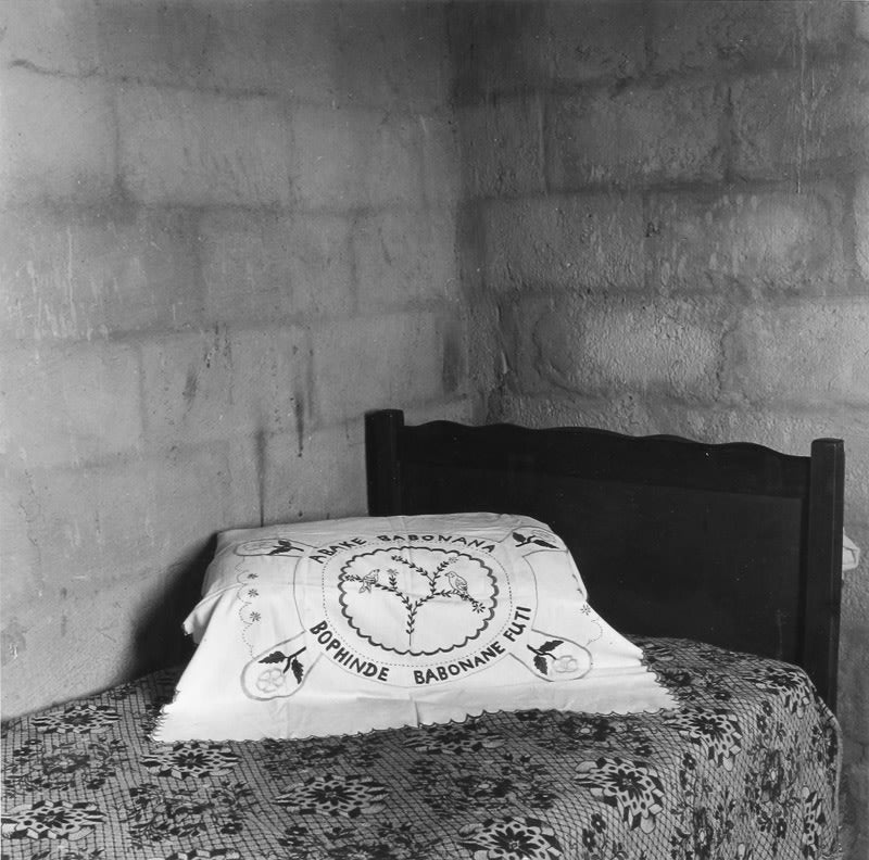"Pillow of Velley Phakati, whose husband has 'gone away'. The inscription she embroidered reads ""those who once met, will meet again"", 2365B Emdeni Extension, Soweto - David Goldblatt 
