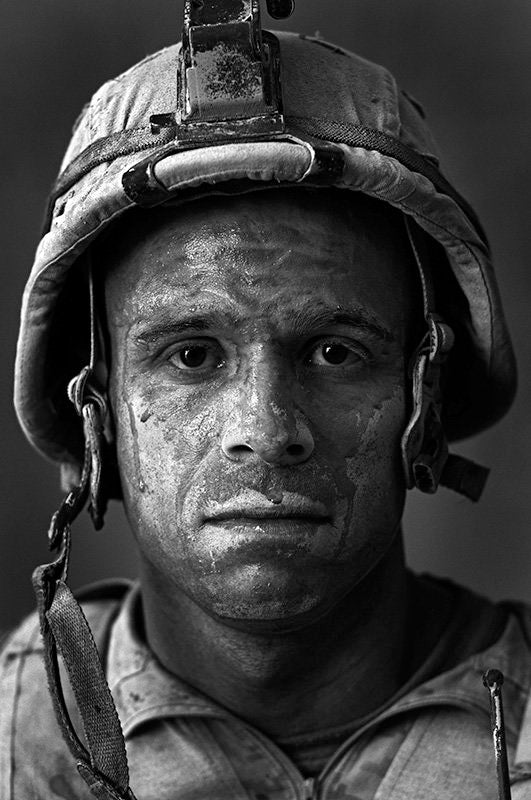 "U.S. Marine Gunnery Sgt. Carlos ""OJ"" Orjuela age 31, Garmsir District, Helmand Province, Afghanistan, Forward Operating Base Dwyer. Carlos is from Neptune, New Jersey and he has done a tour of Iraq in addition to this tour. - Louie Palu 