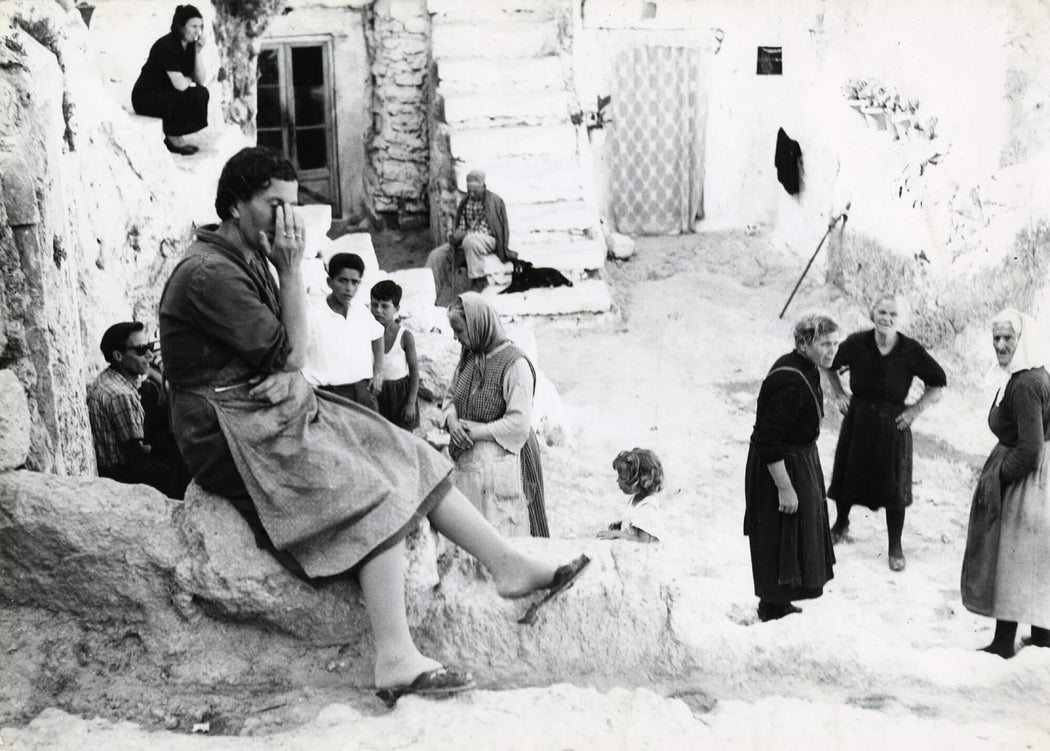 FFOTO-Mario Giacomelli-Gargano (village scene, woman with hand to face)