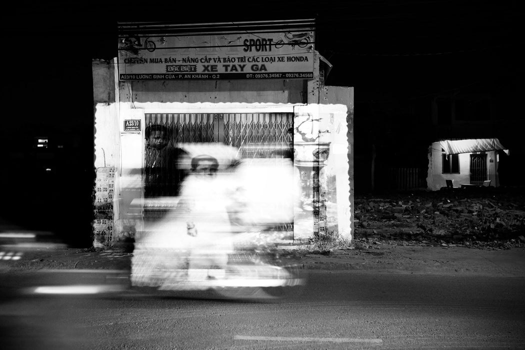 FFOTO-Olivia Marty-La Possibilité d'une Vie (projected on an abandoned shop in an expropriated area, in District 1, Saigon)