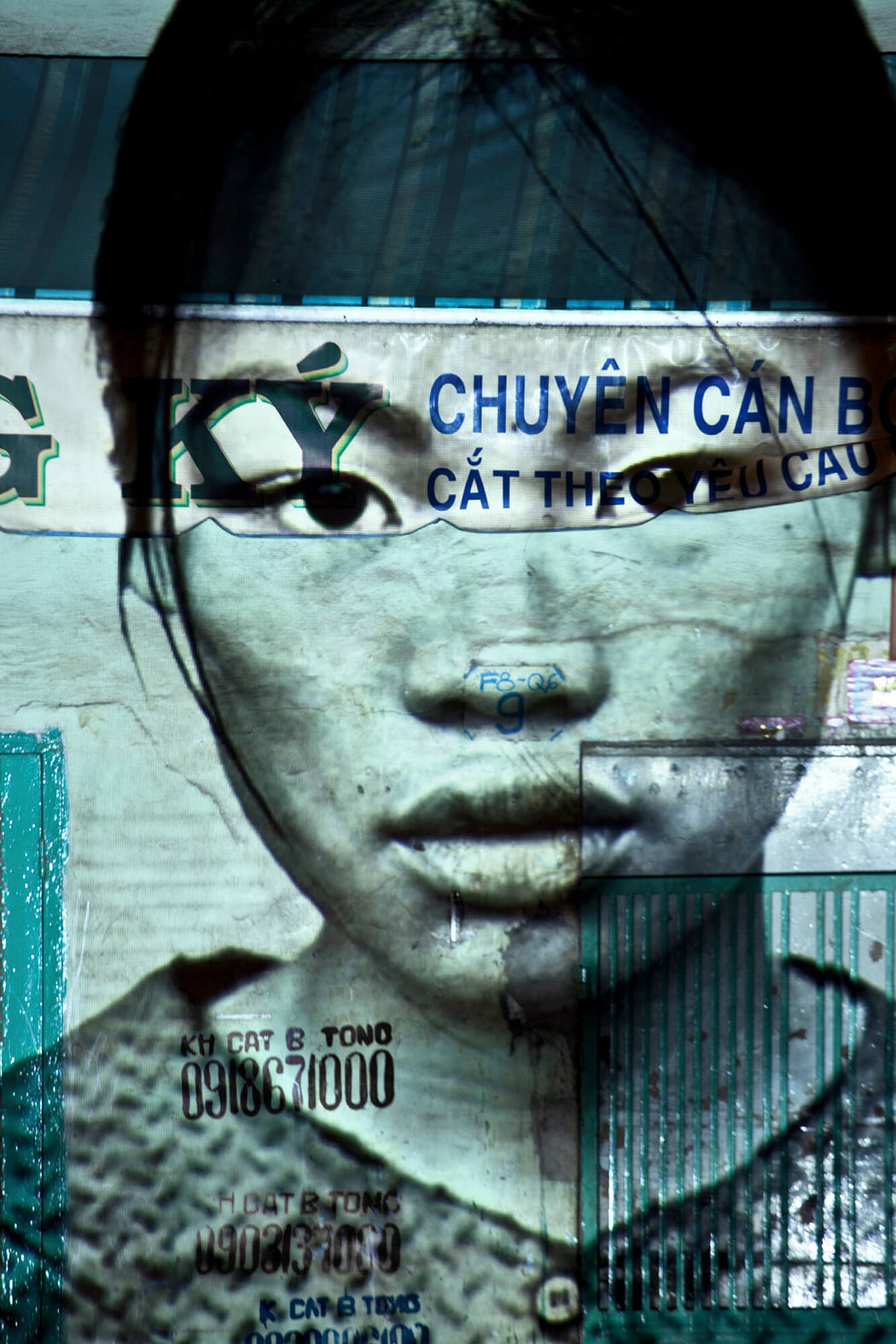 Les Cicatrices de la Nation (projected on a shop frontage, in Cholon)  - Olivia Marty | FFOTO