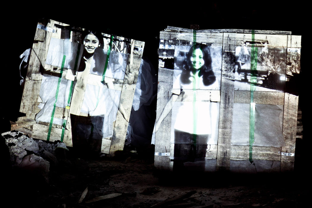 Walking on a Bridge Connecting Two Alien Shores (projected on a building construction site in An Phu, Saigon)  - Olivia Marty | FFOTO