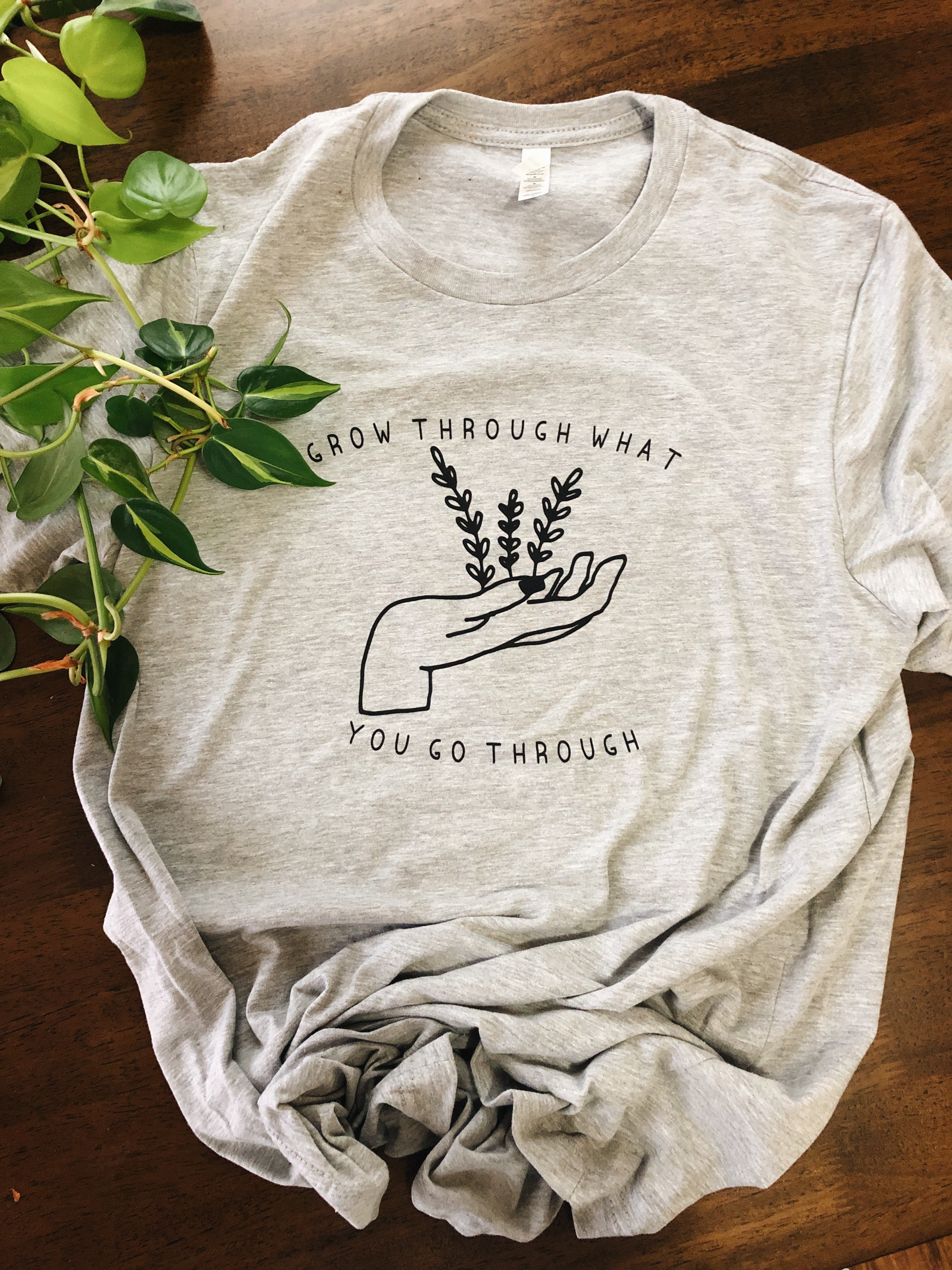 Grow Through What You Go Through Unisex Tee