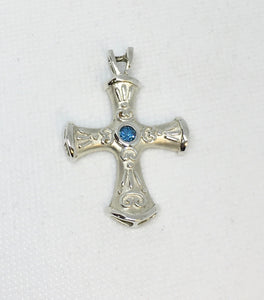 Sterling Silver Cross Pendant with Swiss Blue Topaz Center