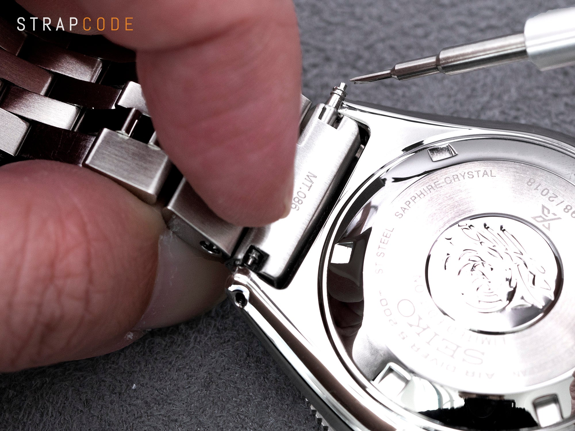 Changing watch band - The spring bar is clear of the lug of the watch case